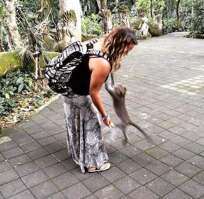 a monkey jumping on my friend at the Ubud Sacred Monkey Forest