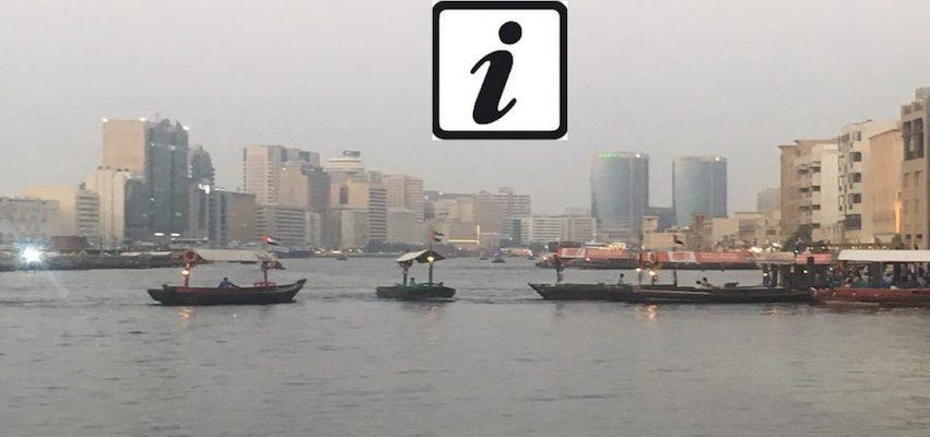 Dubai Creek and Info Sign for Travel Tips for Dubai and Abu Dhabi