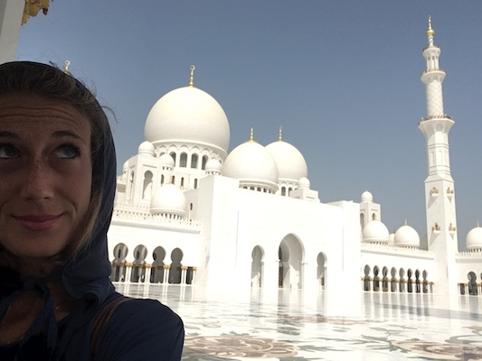 Me and the Grand Mosque of Abu Dhabi during my travel to the United Arab Emirates