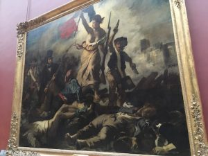 Painting of Liberty leading the people in Louvre
