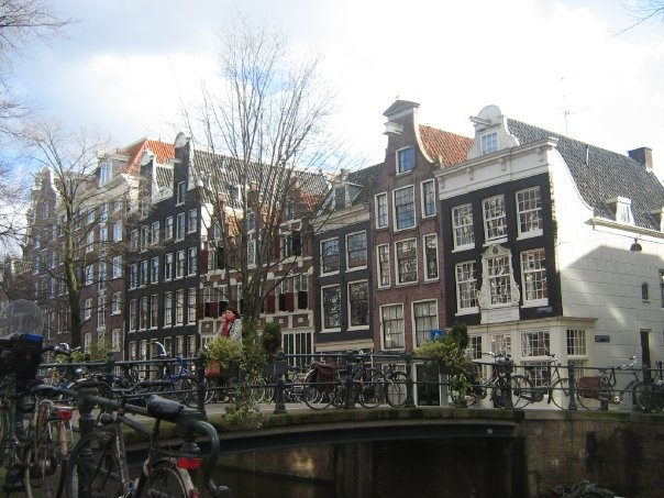 Biking around the canals and the houses of Amsterdam