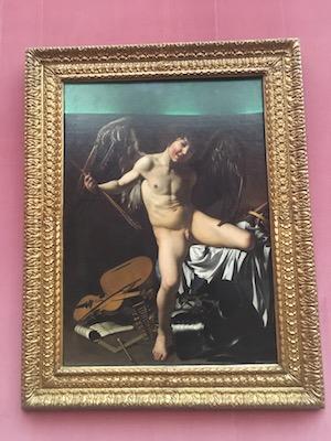 Painting of Amor Vincit Omnia by Caravaggio in Gemaldelgalerie of Berlin