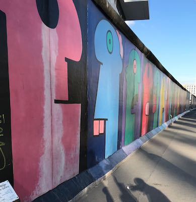 the heads of Thierry Noir at the East Side Gallery