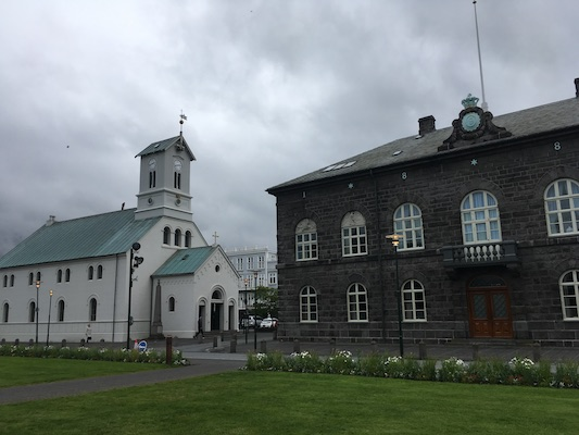 Domkirkjan, the Cathedral of Reykjavik, next to Althingishusid, the Parliament House