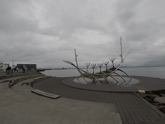 Sun Voyager with Harpa on the background in Reykjavik