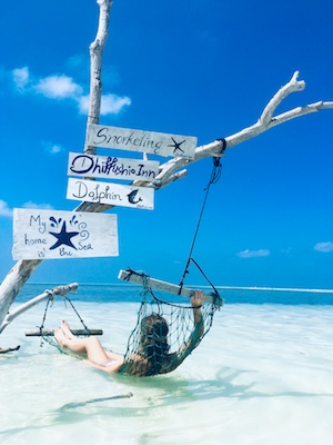 Relaxing on a hammock is one of the things to do on Dhiffushi Island