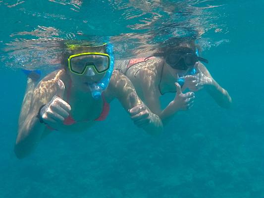 Us snorkeling near Dhiffushi