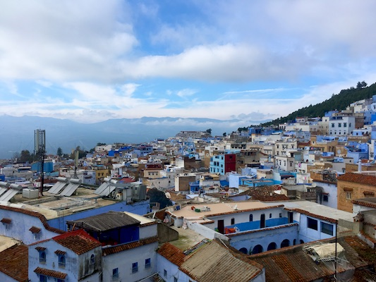 View of the little blue houses of Chefchaouen by the Rif Mountains