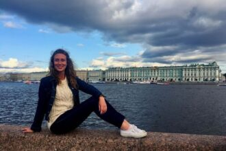Me and the view of the Hermitage including the Winter Palace, one of the top things to do in St Petersburg, Russia